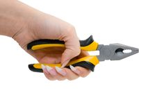 Female hand hold black and yellow pliers Stock Photography