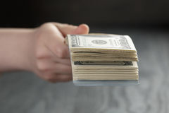Female hand hold bunch of dollars, closeup Royalty Free Stock Photos