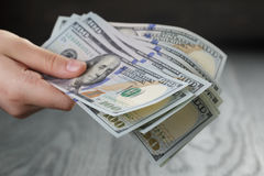 Female hand hold bunch of dollars, closeup Royalty Free Stock Photo
