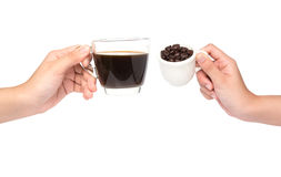Female hand hold cup of coffee beans on white backgroun Stock Photo