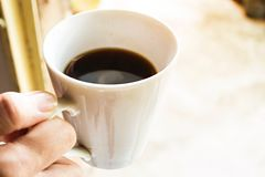 Female hand hold cup of coffee stock photos