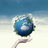 Female hand hold 3D rendered Earth globe. Royalty Free Stock Photos