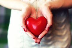 Hand valentine heart woolen stock photography