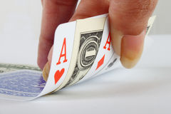 Female hand holding 3 aces and one dollar note Stock Images