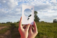 Free Female Hand Holding A Symbol Of Gender Equality Against The Background Of Blue Sky With Clouds Stock Photography - 118886812