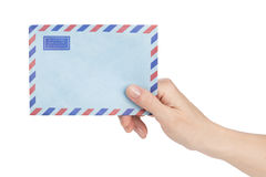Female hand holding air mail envelope Stock Photo