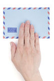 Female hand holding air mail envelope Royalty Free Stock Photos