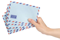 Female hand holding air mail envelopes Royalty Free Stock Photography