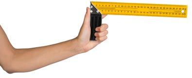 Female hand holding angle ruler Stock Photo