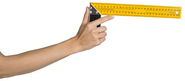 Female hand holding angle ruler Stock Photos