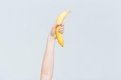 Female hand holding banana Stock Images