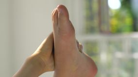 Female hand holding bare foot close-up. Female hand holding bare foot closeup stock video