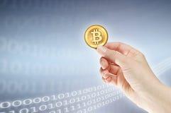 Female hand holding bitcoin Stock Image