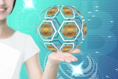 Female hand holding bitcoin icons. With beautiful smiling woman on background stock photography