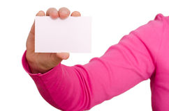 Female hand is holding a blank business card Royalty Free Stock Photo