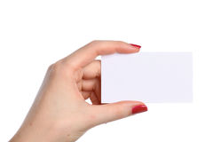 Female hand holding a blank business card Stock Image