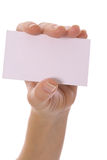 Female hand holding blank card. Isolated on a white background Royalty Free Stock Photo