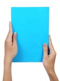Female hand holding a blank paper blue. Isolated on white background Royalty Free Stock Photo