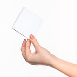 Female hand holding blank paper for records on white. Royalty Free Stock Image