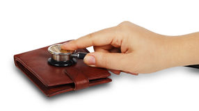 Female hand holding blood pressure meter on a purse Royalty Free Stock Image