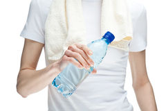 Female hand holding bottle of drinking water Stock Images