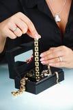 Female hand holding bracelet Royalty Free Stock Photo