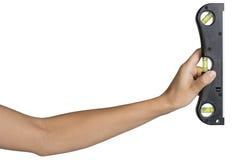 Female hand holding builder's level Stock Image