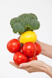 Female hand holding a bunch of vegetables Stock Photography