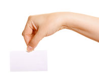 Female hand holding a business card. On a white background Stock Photo