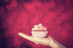 Female hand holding cake Royalty Free Stock Photo