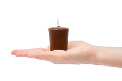 Female hand holding candle. Isolated on white background Stock Image