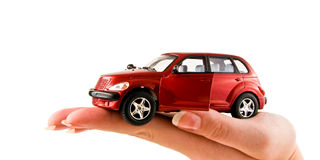 Female hand holding a car. Isolated on white Stock Photography