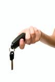 Female hand holding a car key. Female hand holding car key Stock Photography