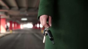 Female hand holding car key with remote control stock video footage