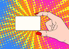 Female hand with holding a card on bright dot background in pop. Art comic style. Hand drawing vector illustration Royalty Free Stock Images