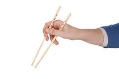 Female hand holding chopsticks stock images