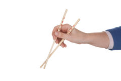 Female hand holding chopsticks Stock Image