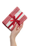 Female Hand Holding Cloth Gift Pack Stock Images
