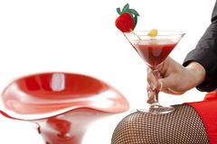Female hand holding cocktail drink in bar isolated Royalty Free Stock Image