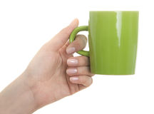 Female hand holding coffee mug Stock Images