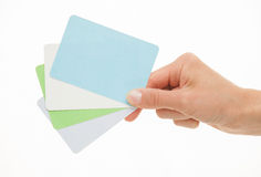 Female hand holding colorful paper cards Stock Image