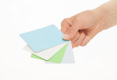 Female hand holding colorful paper cards Royalty Free Stock Photography