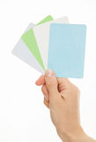 Female hand holding colorful paper cards Stock Photography