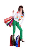 Female hand holding colorful shopping bags Stock Photos