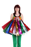Female hand holding colorful shopping bags Royalty Free Stock Photography
