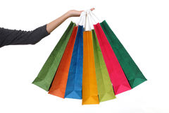 Female hand holding colorful shopping bags Stock Photo