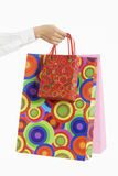 Female hand holding colorful shopping bags Stock Images