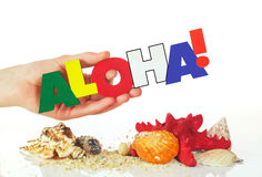 Female hand holding colorful word Aloha Stock Photography