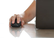 Female hand holding computer wireless mouse Royalty Free Stock Image