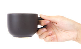 Female hand holding a cup of coffee. Stock Photos